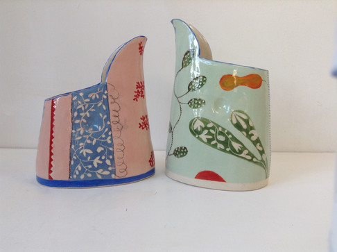 two small jugs pink and green no handles
