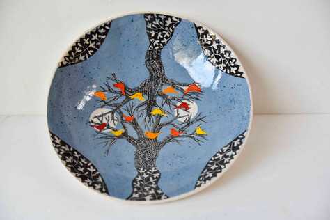 interlocking trees with coloured birds plate