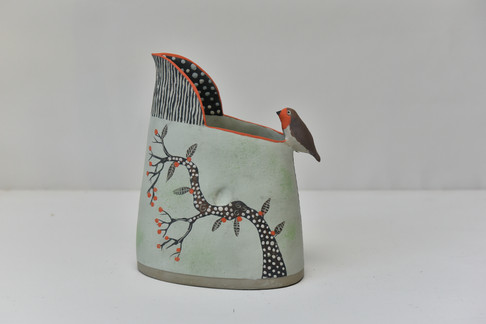 pale green small jug with robin and styl