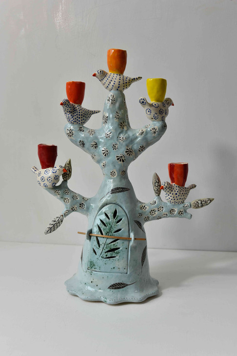 pale blue candelabra with acid colour cups and spotty birds