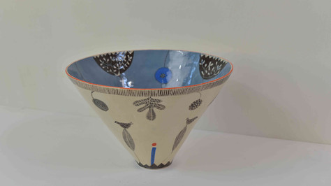 tall B&W bowl, orange rim and blue inside