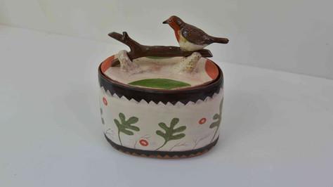 terracota box, robin sitting on log