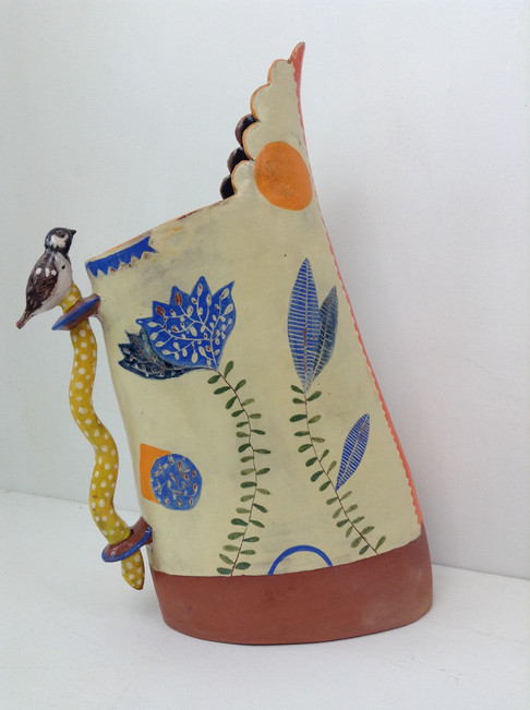 terracotta and yellow leaning jug, wavy