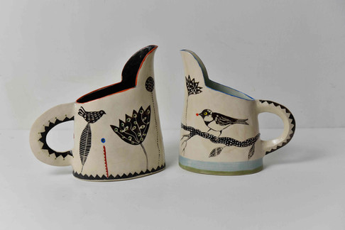 small b&w jugs, birds on twig, carved handle