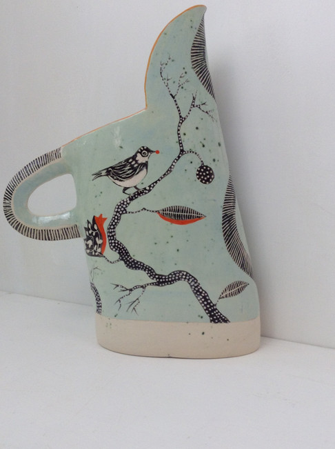 pale blue tall jug, coal tit with red be
