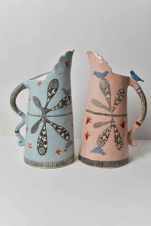 tall blue and pink mirror image jugs with ornamental spouts