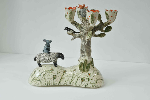 Candelabra with sheep, hare and magpie