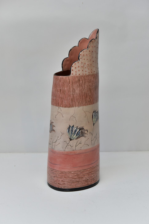 tall vase with flower seeds.jpg
