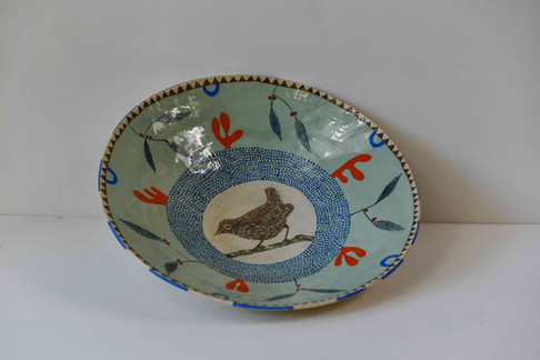 Large blue bowl with bird in centre