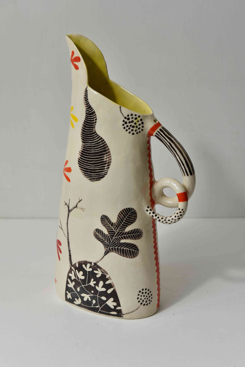 tall jug, double curl handle and orange and black leaf design