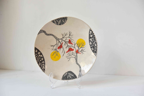 tree plate with red birds and suns.jpg