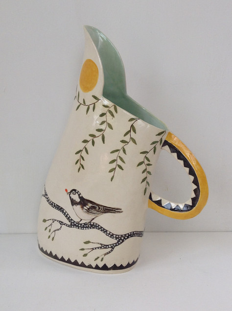 white jug carved handle yellow sun, tit
