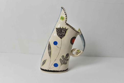 tall black, white and lime jug, curley handle