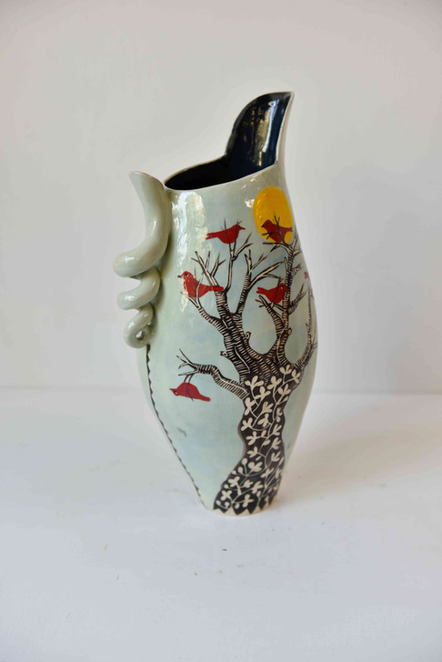 tall round jug with tree and red birds