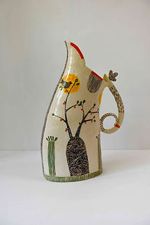 tall white dancing jug with branches.jpg