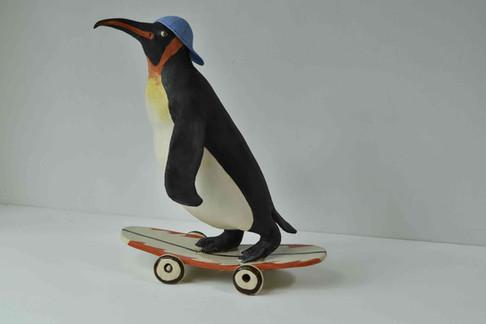 Skateboarding penguin