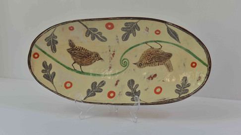 oval yellow platter with balancing birds