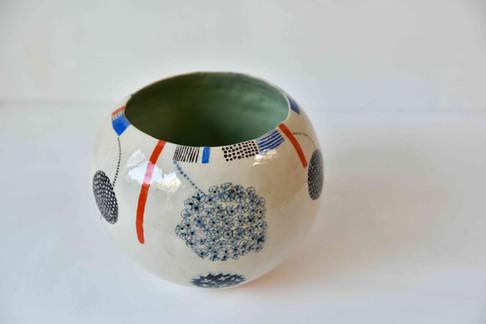 round bowl with patterns and alium.jpg