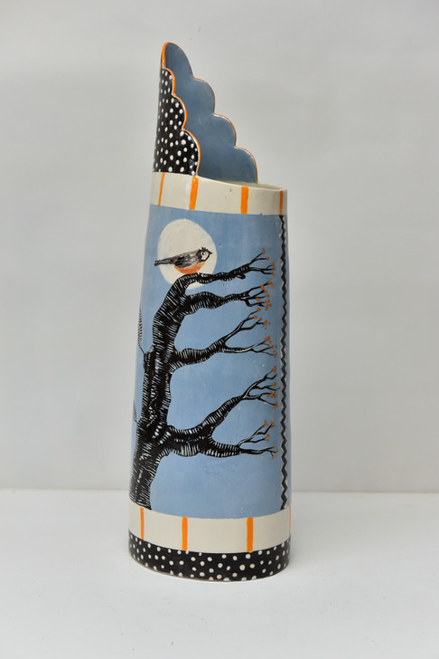 tall cylindrical jug with coal tit in mo
