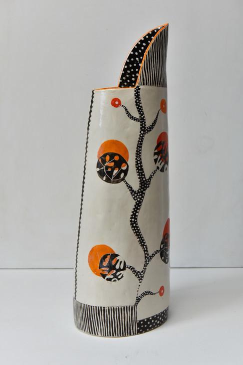 tall slender orange black jug (1).jpg