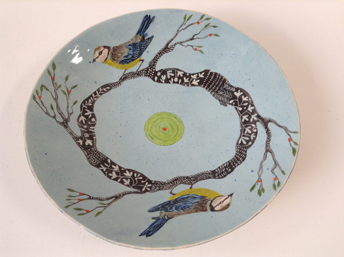 large blue plate branches and blue tits.