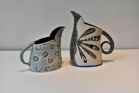 small blue imprint jug & b&w fan design jug