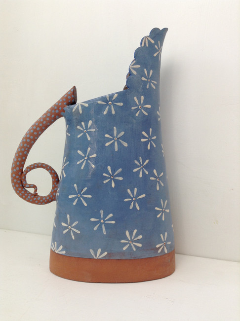 terracotta and blue jug, white daisy and