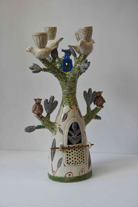 tree candelabra with four birds and two owls