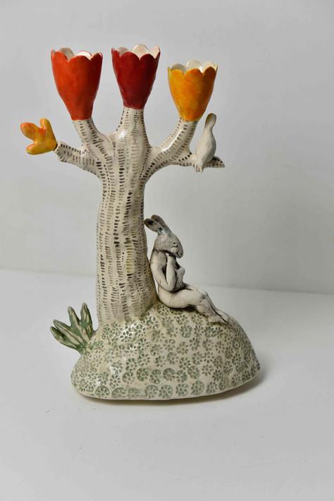 three orange cups and pensive hare candelabra