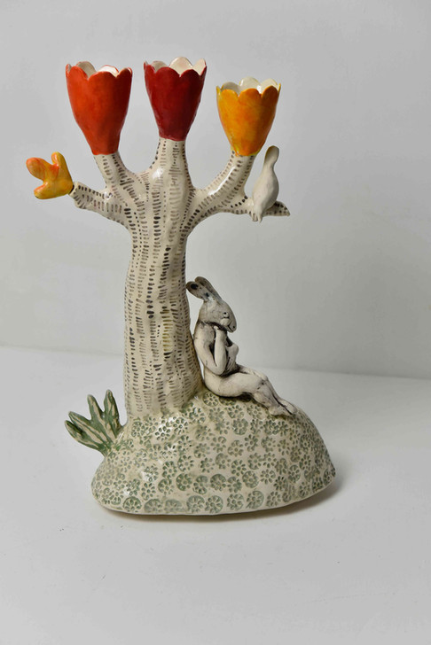 three orange cups and pensive hare candelabra