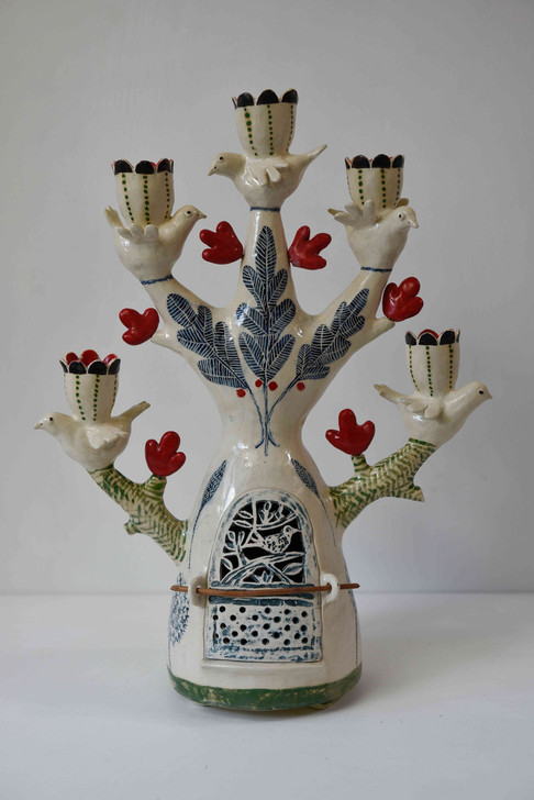 Five bird candelabra with red heart shapes