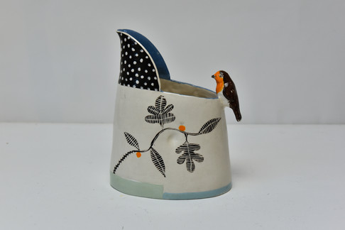 small black and white jug with robin and