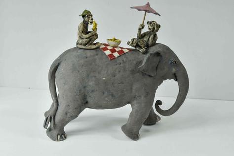 Elephant and monkeys picnic