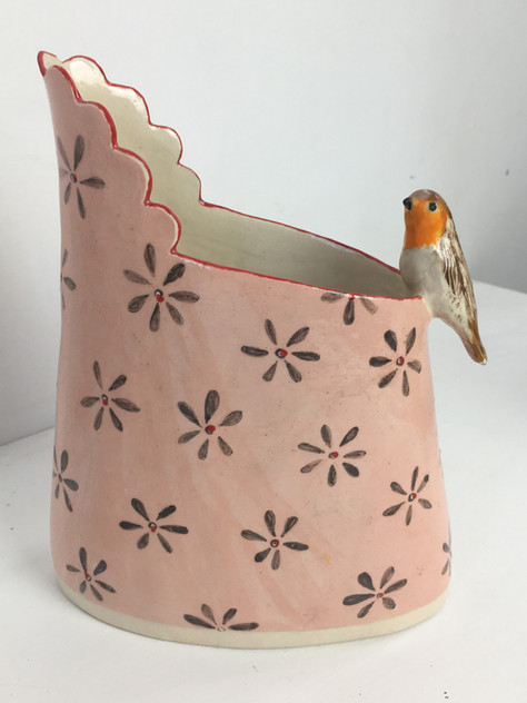 small pink jug with grey daisy and robin