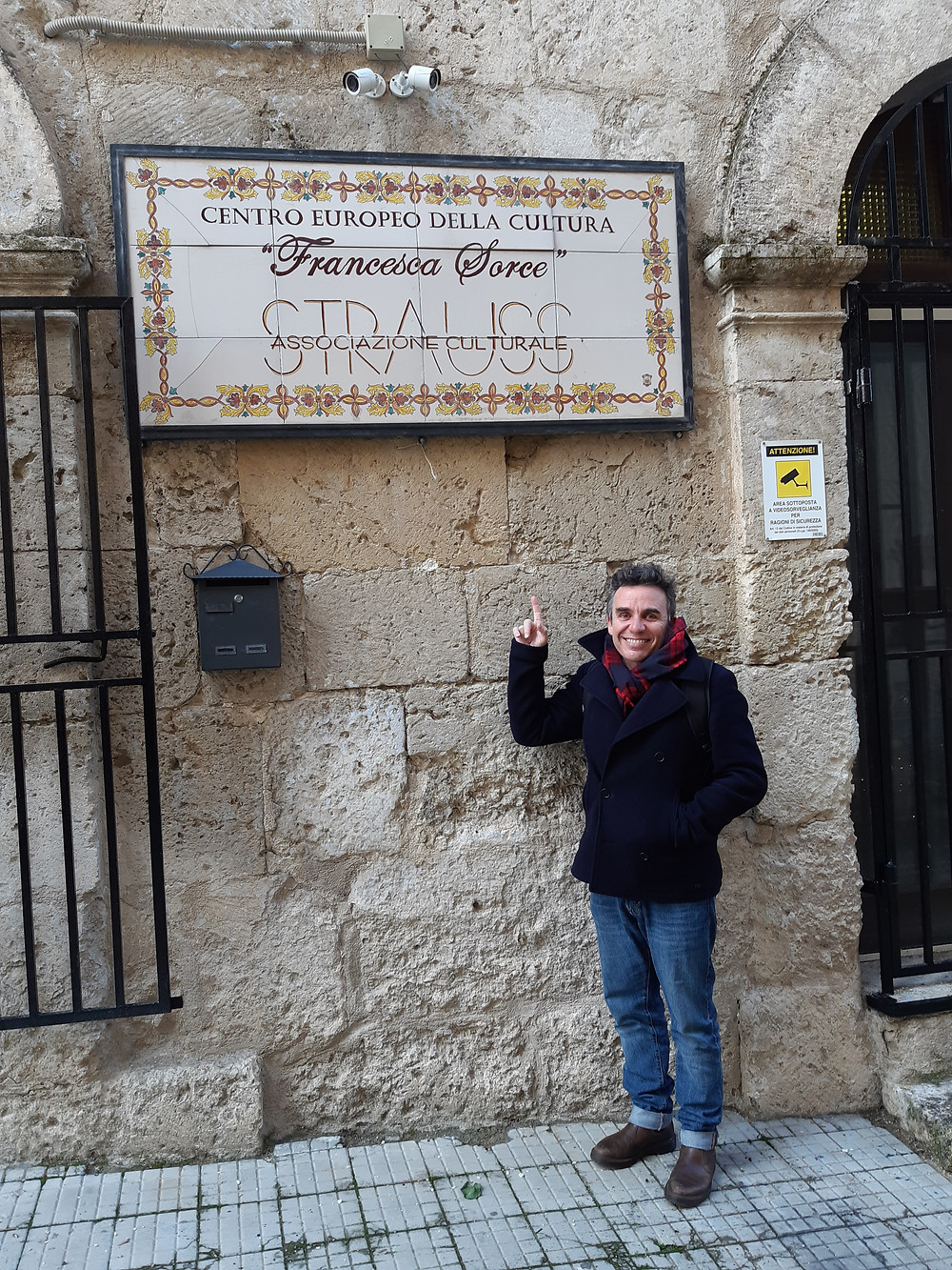 This is me standing outside of the Strauss Association here in Mussomeli, Sicily.