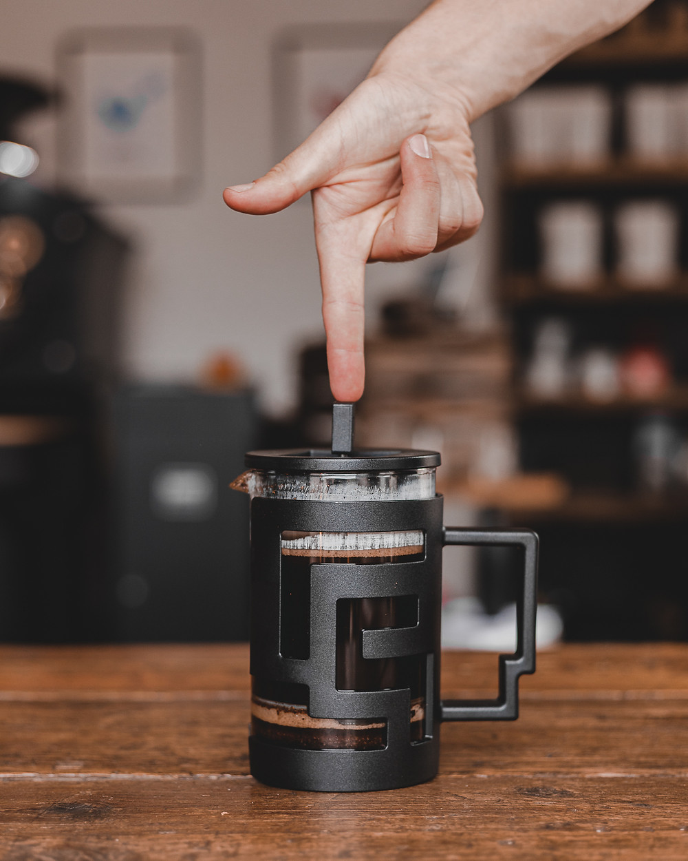 Timemore French Press being pressed with one finger at Unorthodox Roasters