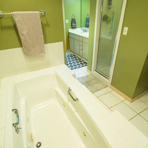 Jacuzzi tub, walk-in shower.
