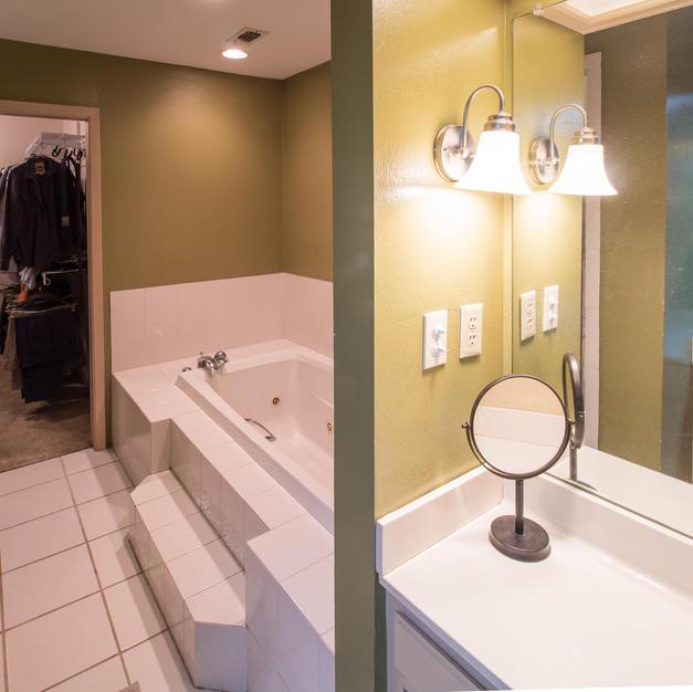 Vanity, jacuzzi tub, walk-in closet.