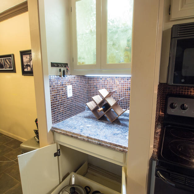 Kitchen nook w/ pull out drawer.