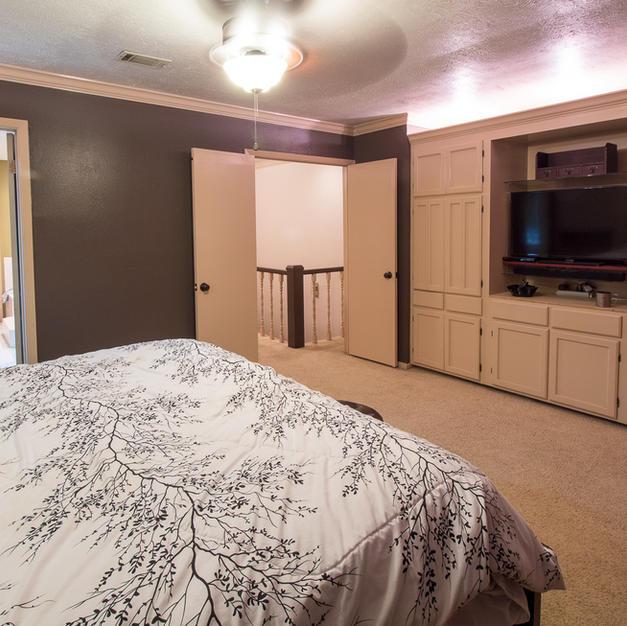 Master bedroom w/ built-ins.