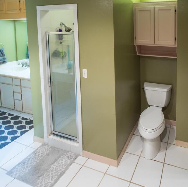 Walk-in tiled shower, privacy toilet.