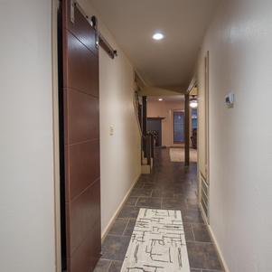 Entranceway w/ barn door to coat closet.