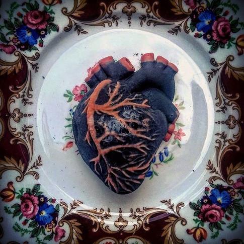 A glass heart while still frozen.