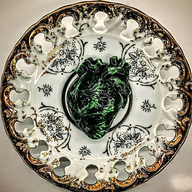 Amazon Heart (Green Palpitation) on a 1950s Japanese reticulated porcelain saucer. On display at the Kabinett Gallery.