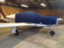 Piper Arrow in hangar