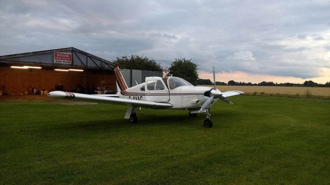 Piper Arrow outside hangar