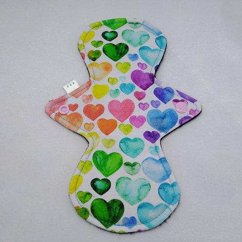 "9""  Oeko-Tex Jersey, regular cloth pad,  Rainbow hearts on white."