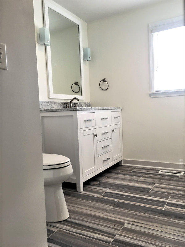White and Grey Guest Bathroom..jpg