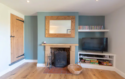 Sitting Room showing wood fire
