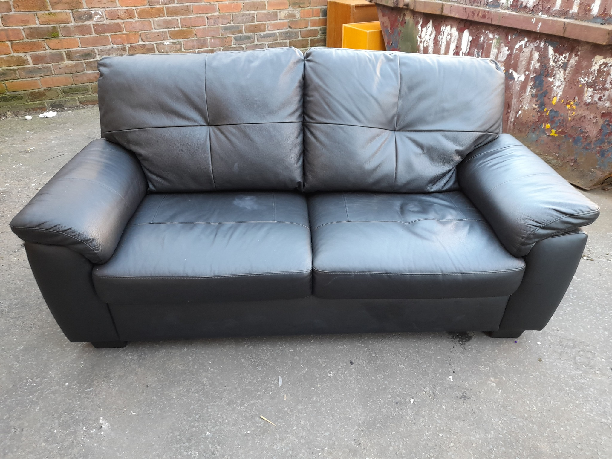 BLACK FAUX LEATHER TWO SEATER SOFA £95